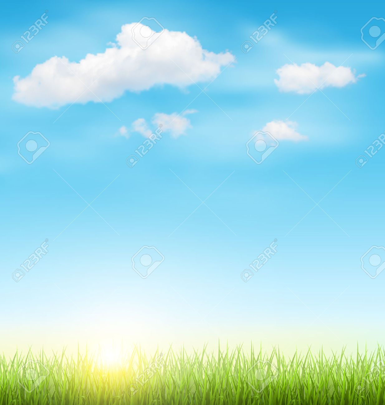green grass lawn with clouds and sun on light blue sky royalty free