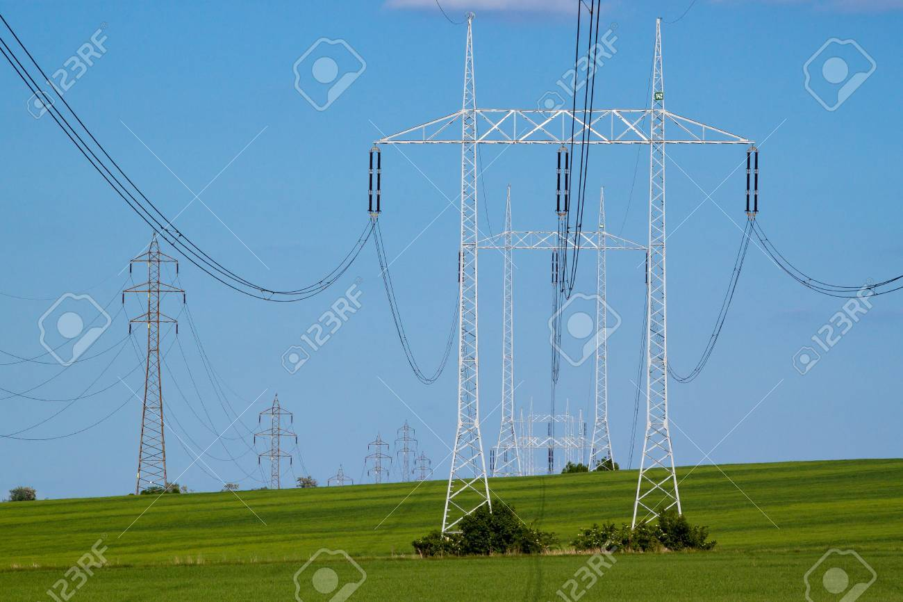 Power lines going into the distance across rural country Stock Photo - 13815548