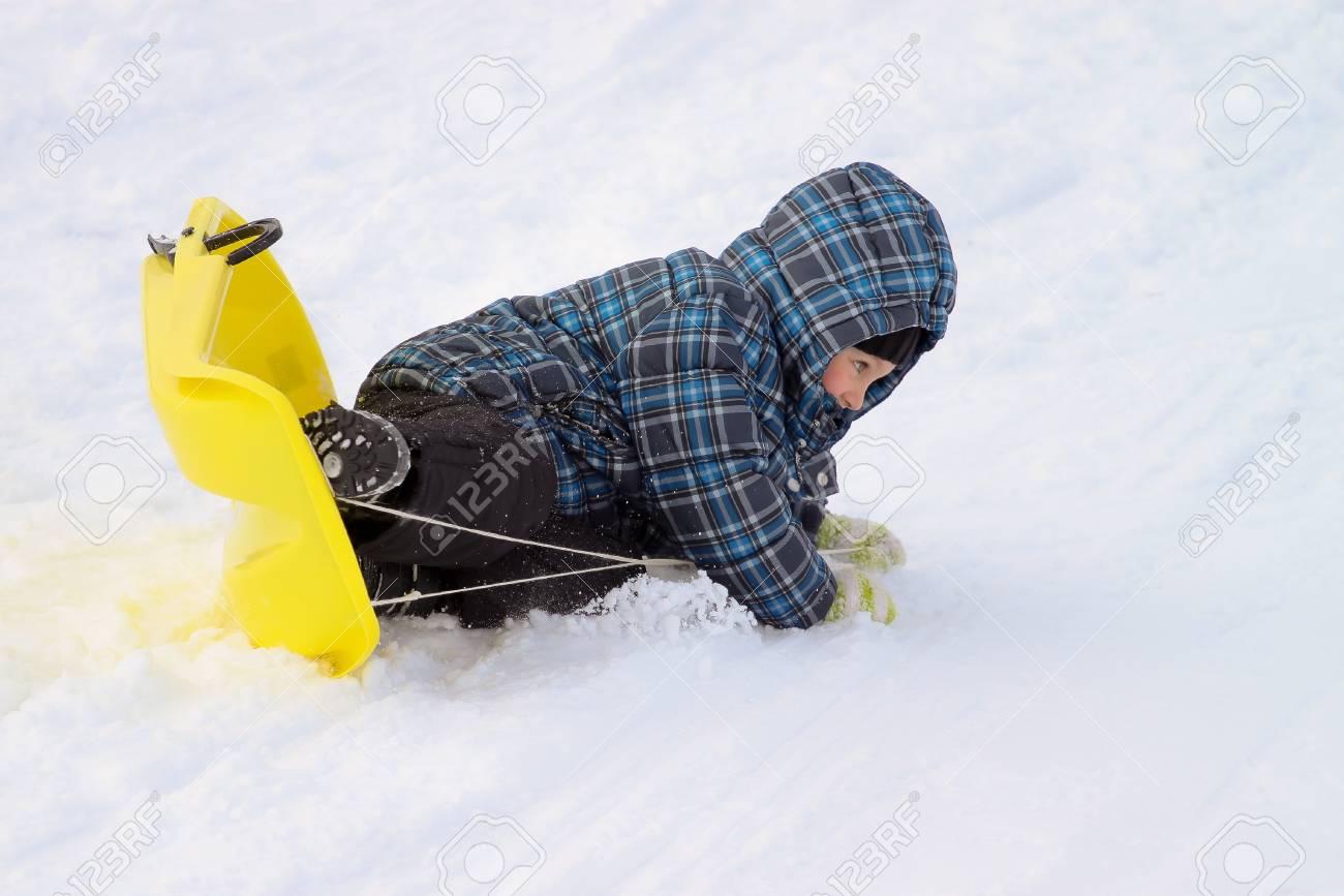 Little boy on sleigh - doing an overturn crash Stock Photo - 17534905