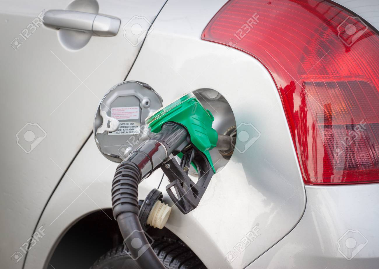 Car refuel - Grey car at gas station being filled with fuel Stock Photo - 19665624