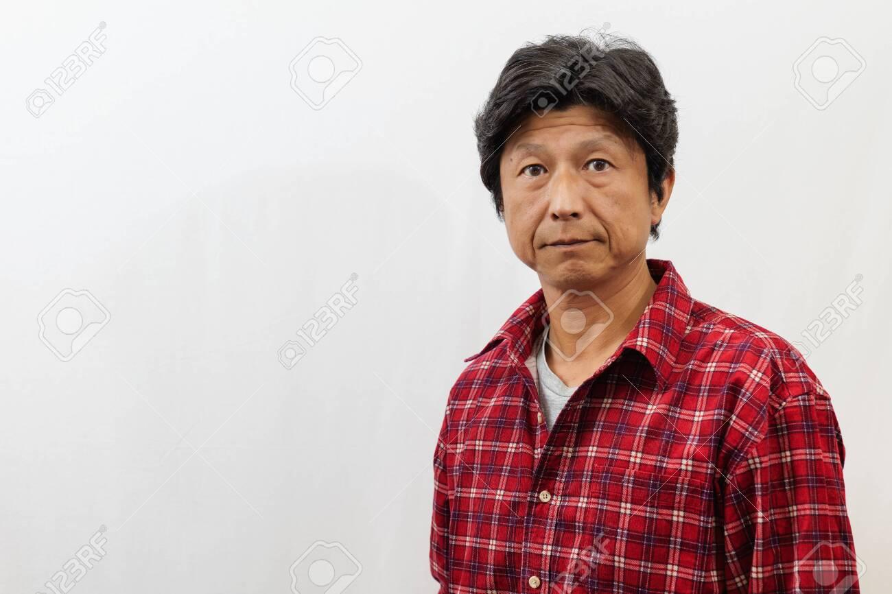 Japanese man photographed on white background - 138996783