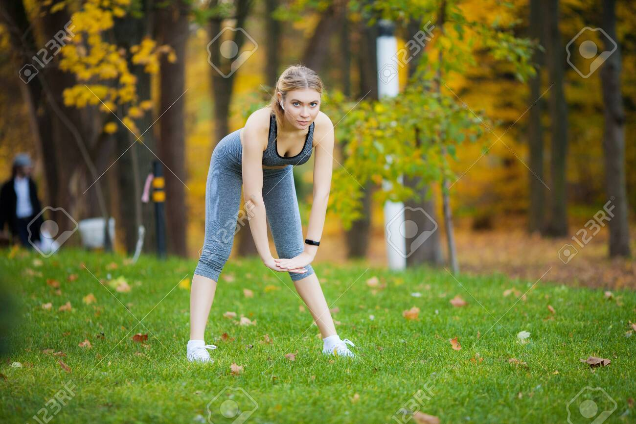 Fitness. Woman doing stretching exercise on park - 123952811