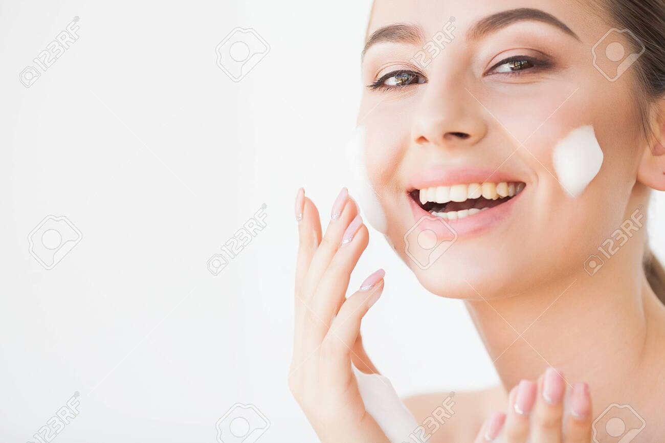 Beauty Face Care. Woman With Cream On Facial Skin - 123953581