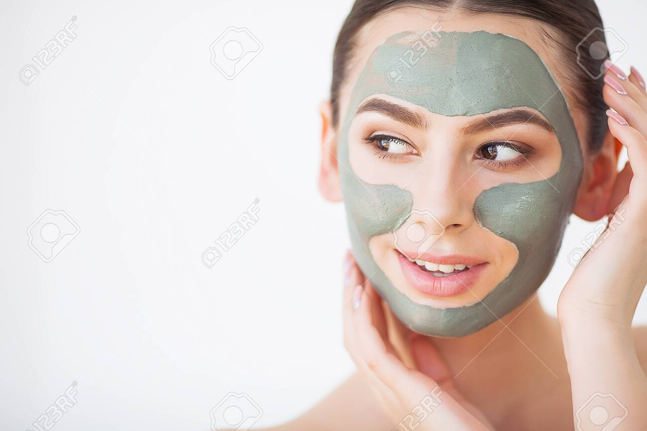 Skin Care. Young Woman With Cosmetic Clay Mask Holding Cucumber At Her Bathroom - 126601670