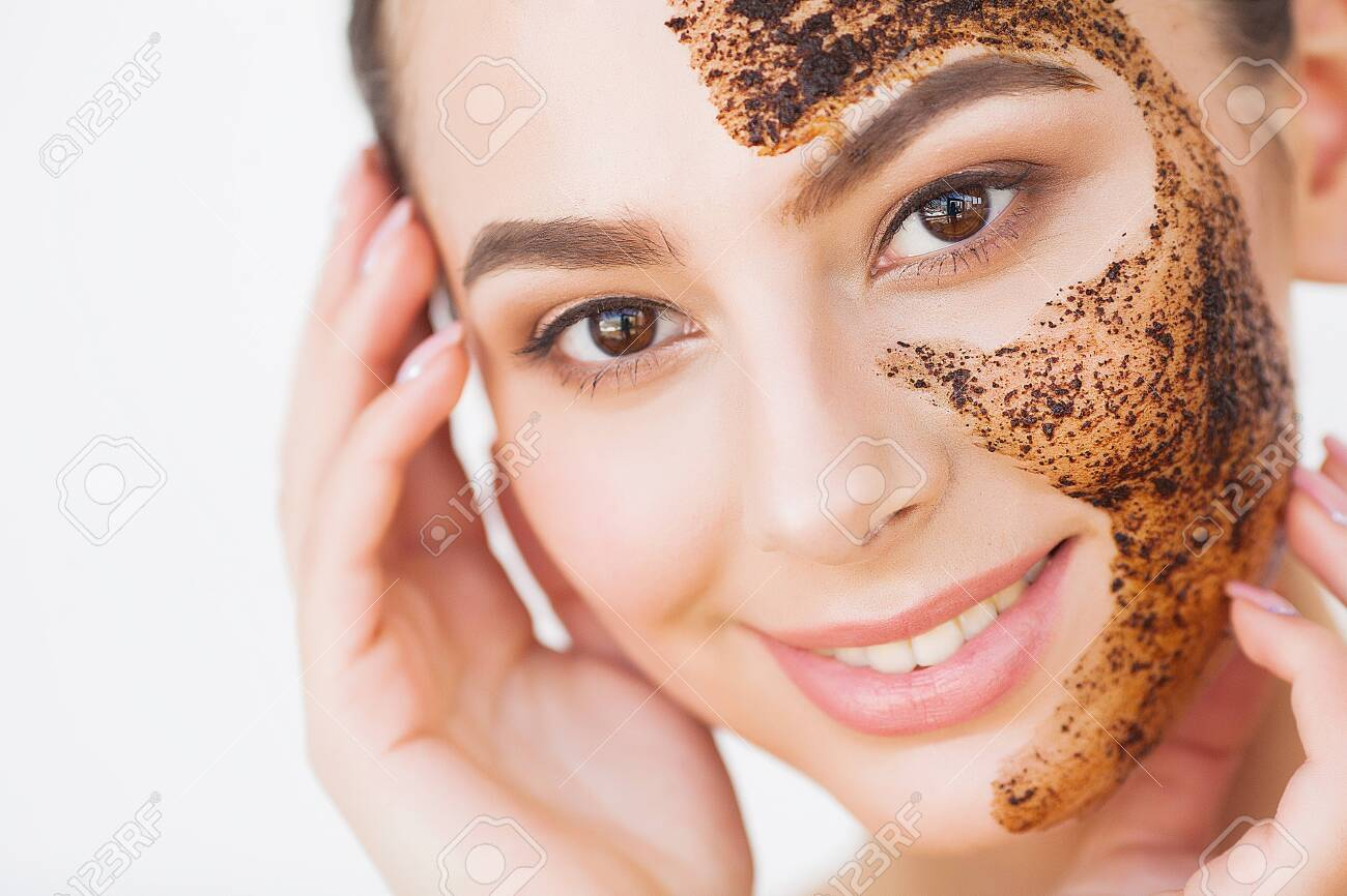 Face Skincare. Young Charming Girl Makes a Black Charcoal Mask on Her Face - 126601907
