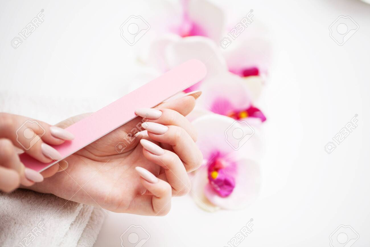 Woman in a beauty studio doing a new manicure. - 147387823