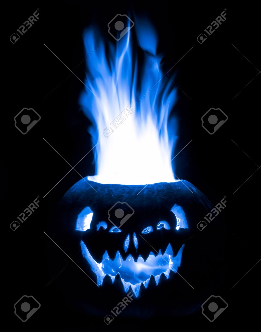 a halloween jack o lantern pumpkin that is emitting electric blue fire isolated on