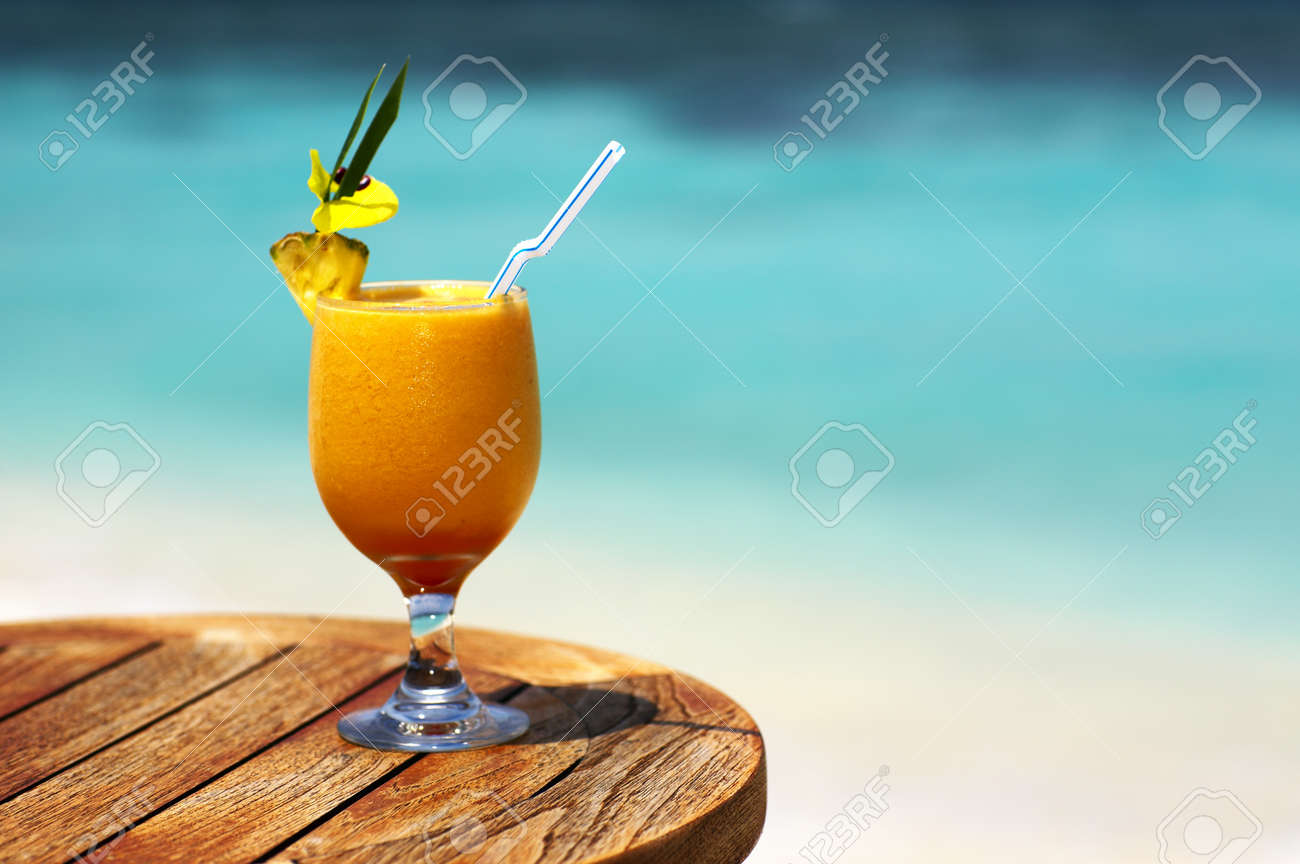 Bocal of fruity cocktail on a beach table Stock Photo - 13103265
