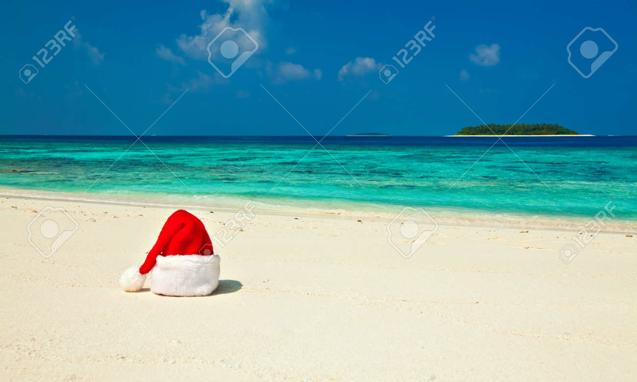 Santa hat is on coral sandy beach Stock Photo - 13220085