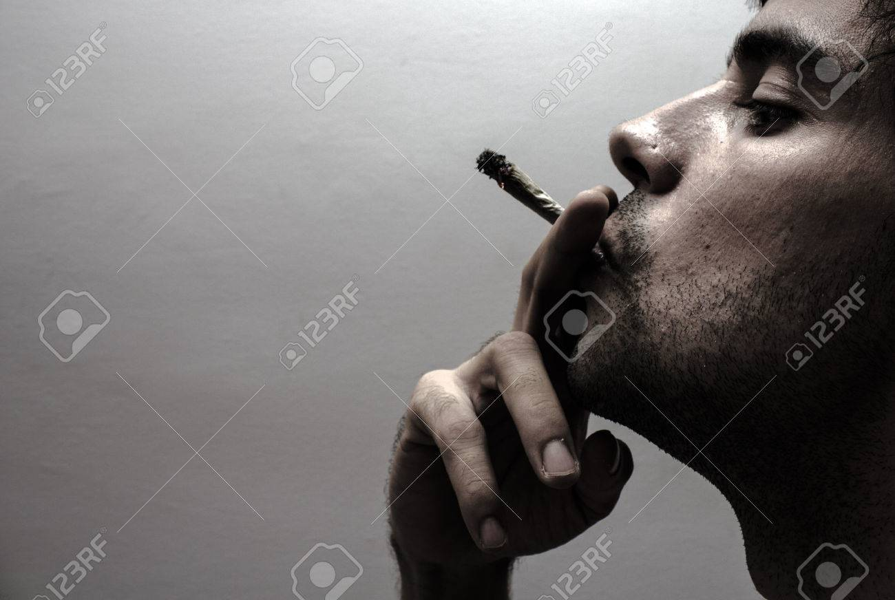 Profile of a person smoking - 23202353