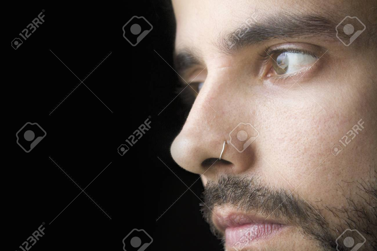 Close-up of a young man with beard - 23202373