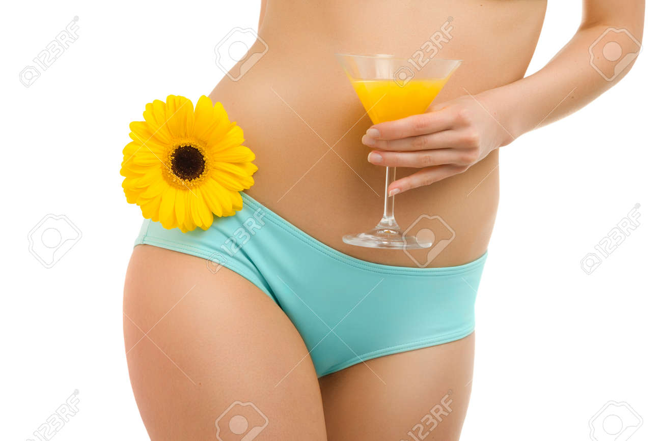 A woman with a glass of orange juice and yellow gerbera Stock Photo - 13370448