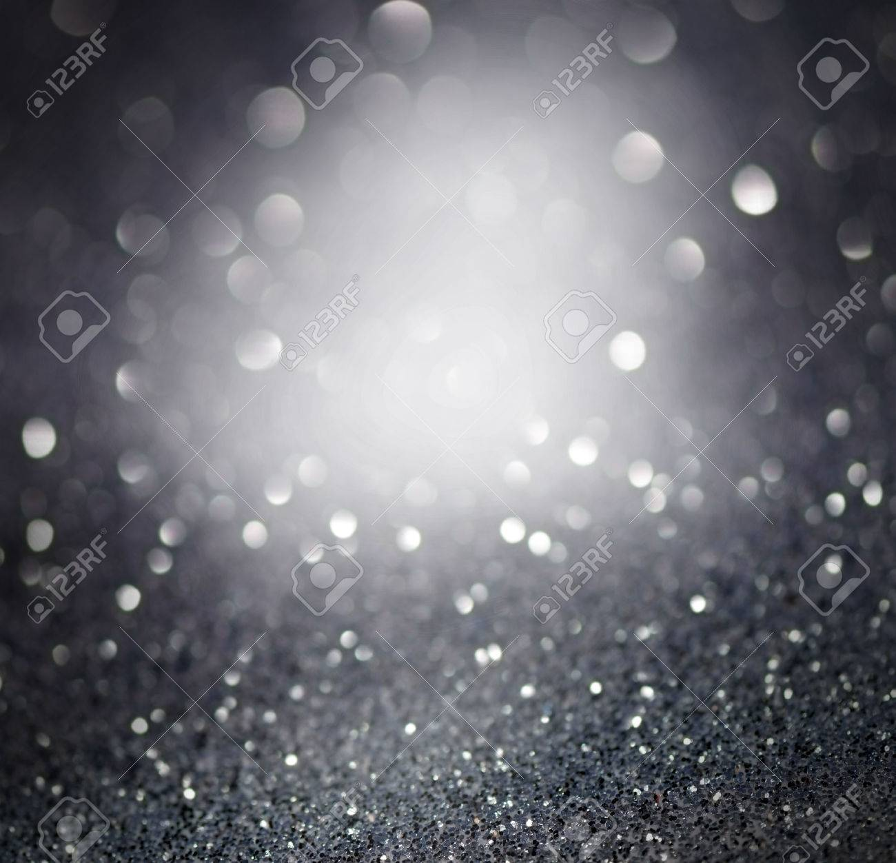 silver glittering christmas lights blurred abstract background stock photo 48804255 - Silver Christmas Lights