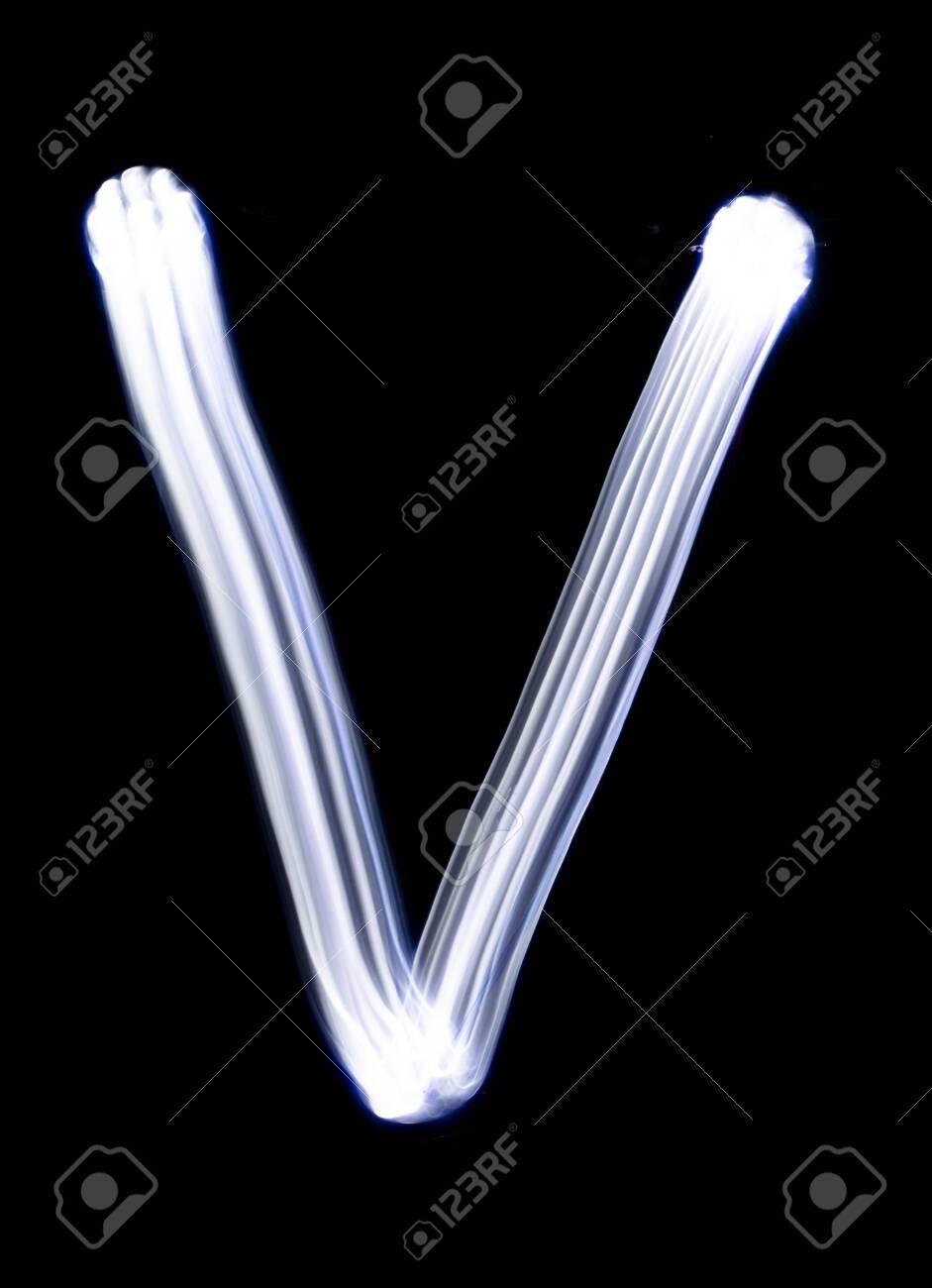 Handwrite letter V, made with light painting technic isolated on black. Light effect font of full alphabet set of upper case letters. - 149660765