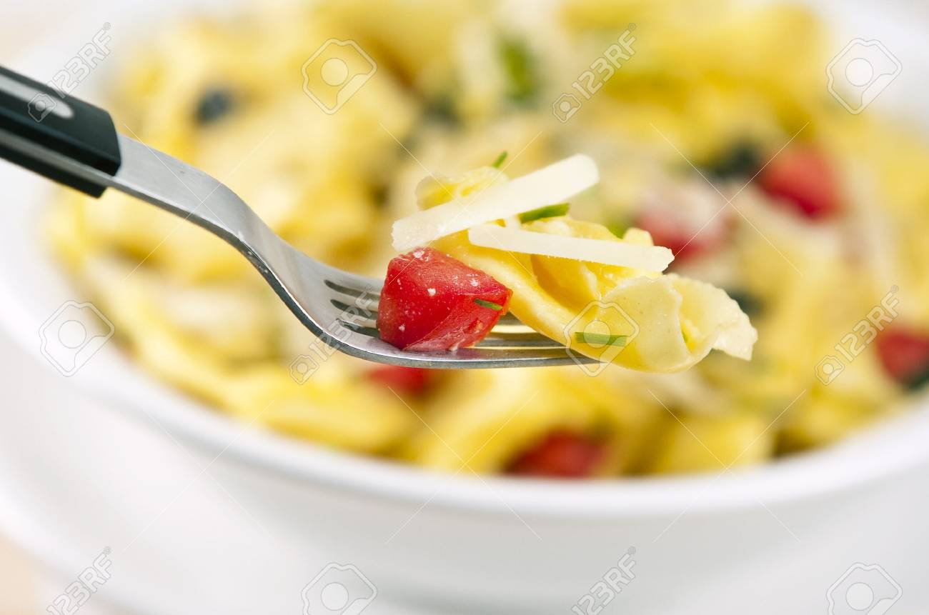 Tortellini primavera garnished with basil leaves on white plate Stock Photo - 5183904