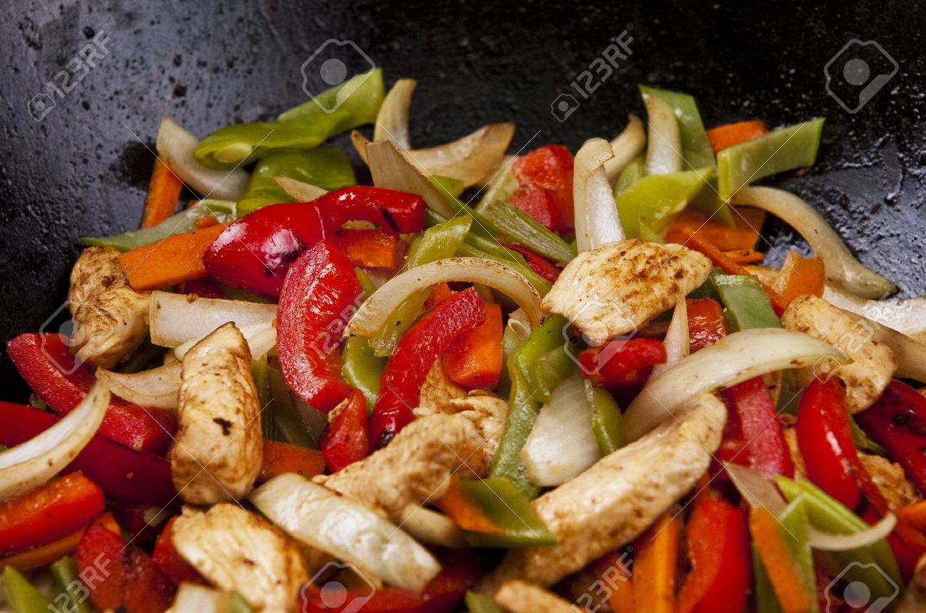 Chicken stir fry with red peppers onion and green beans stock photo chicken stir fry with red peppers onion and green beans forumfinder Images