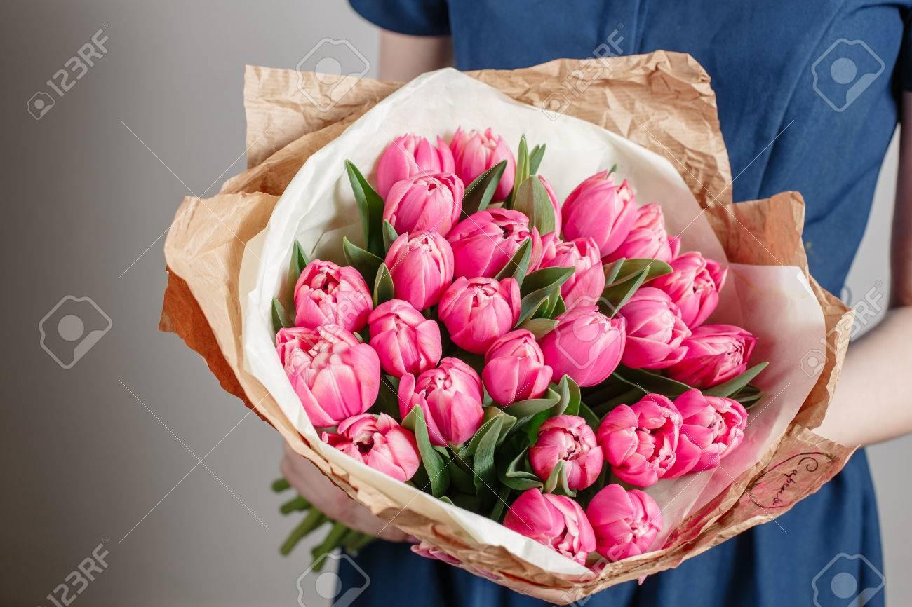 Florist girl with peony flowers or pink tulips young woman with florist girl with peony flowers or pink tulips young woman with flower bouquet for birthday or izmirmasajfo
