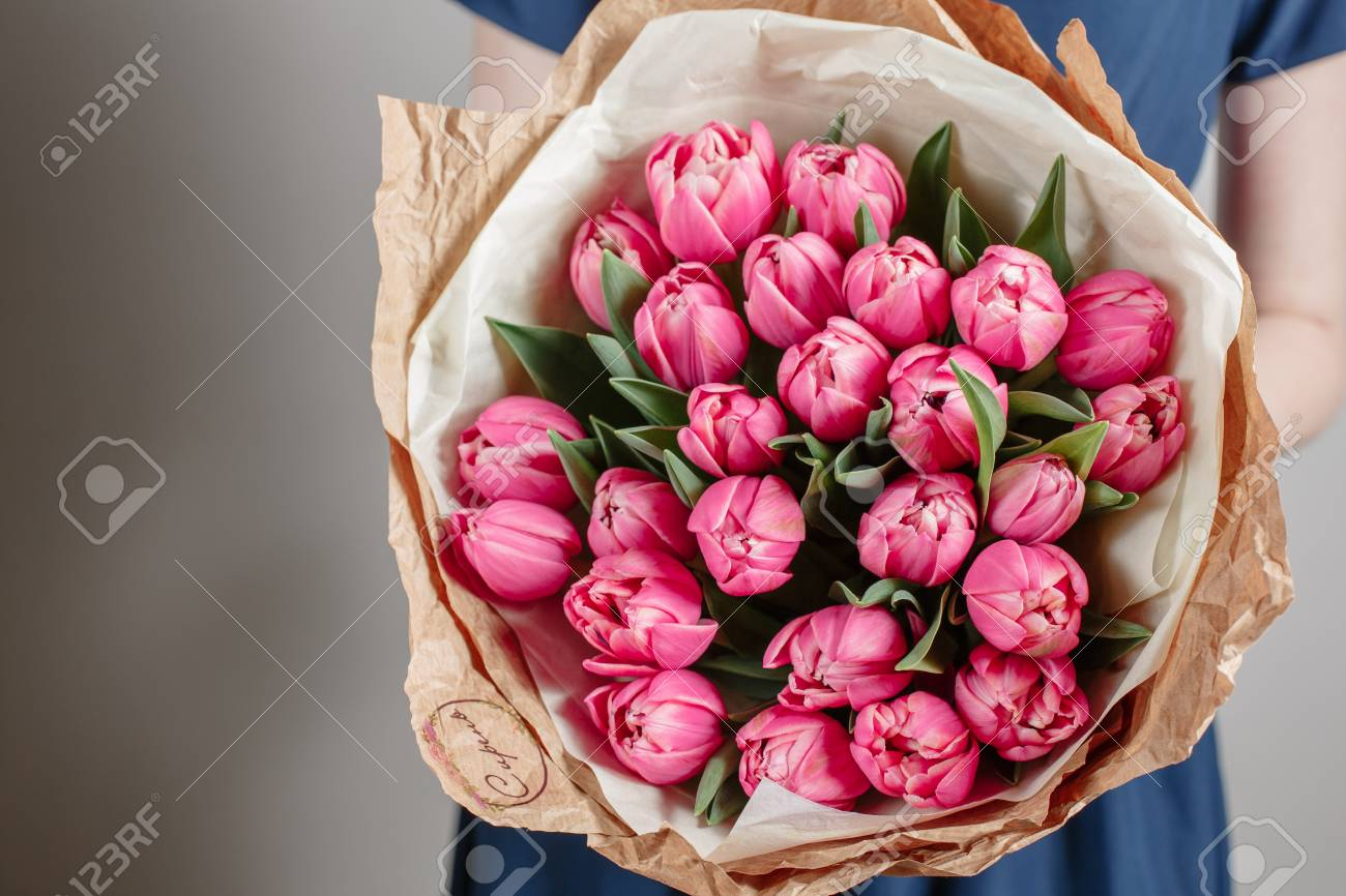 Florist girl with peony flowers or pink tulips young woman with florist girl with peony flowers or pink tulips young woman with flower bouquet for birthday or izmirmasajfo