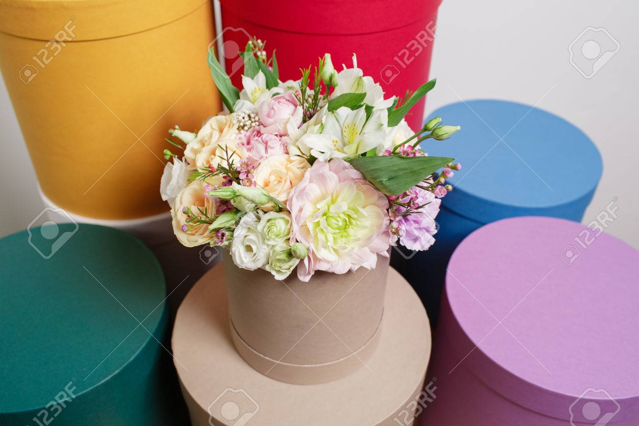 Work florist bouquet in a round box smelling flowers holding stock photo work florist bouquet in a round box smelling flowers holding peach roses bouquet in hat box against the plastered wall izmirmasajfo
