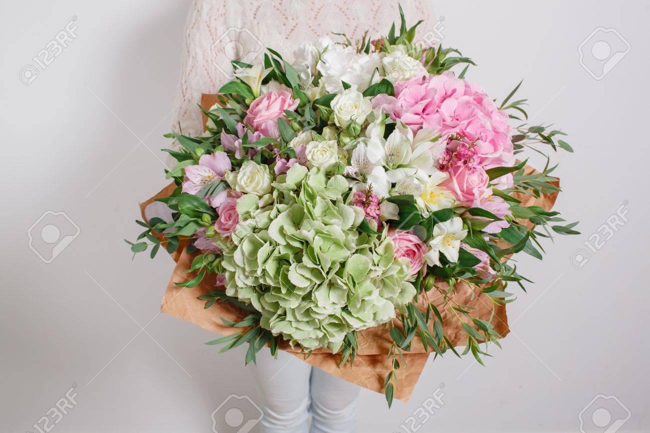 Florist at work. Make hydrangea rich bouquet. colorful roses - 62890231