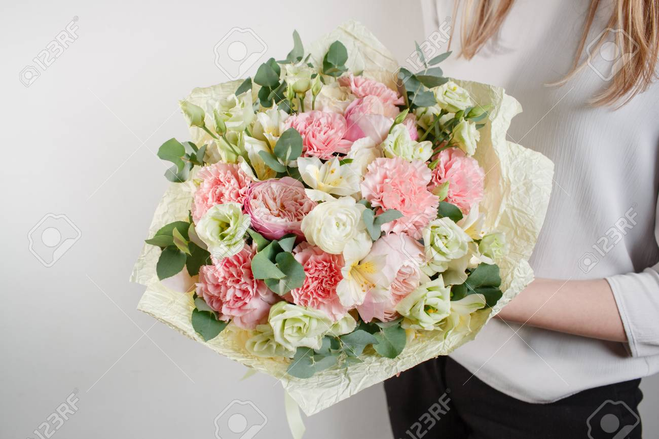Beautiful bouquet made of different flowers with in woman hand beautiful bouquet made of different flowers with in woman hand colorful color mix flower izmirmasajfo Gallery