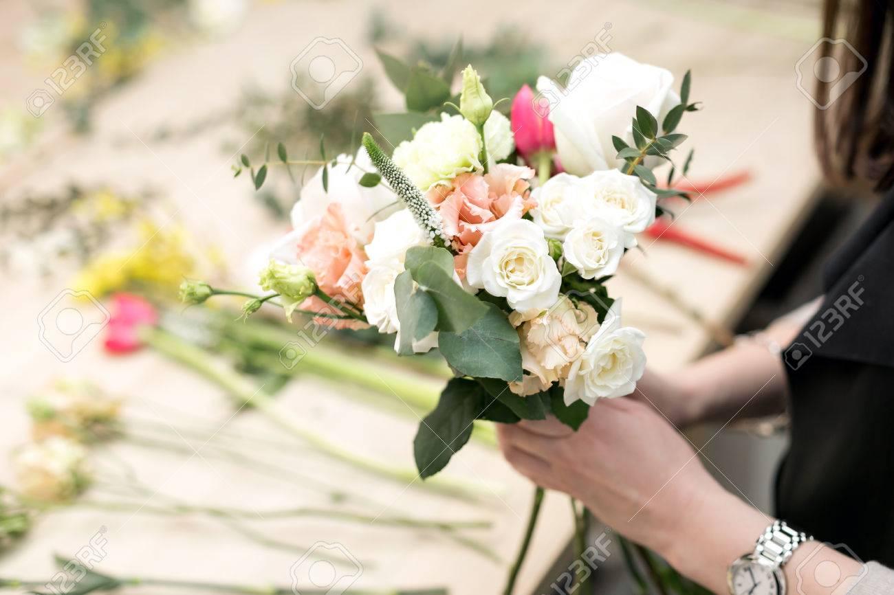 Workshop florist making bouquets and flower arrangements woman stock photo workshop florist making bouquets and flower arrangements woman collecting a bouquet of flowers soft focus izmirmasajfo Gallery