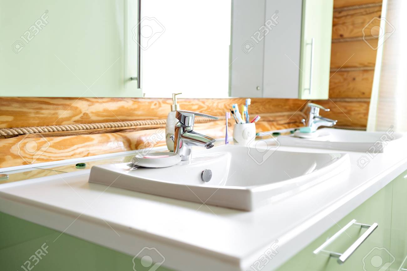 The Bathroom In A Rustic Log Cabin, In The Mountains. With A.. Stock ...