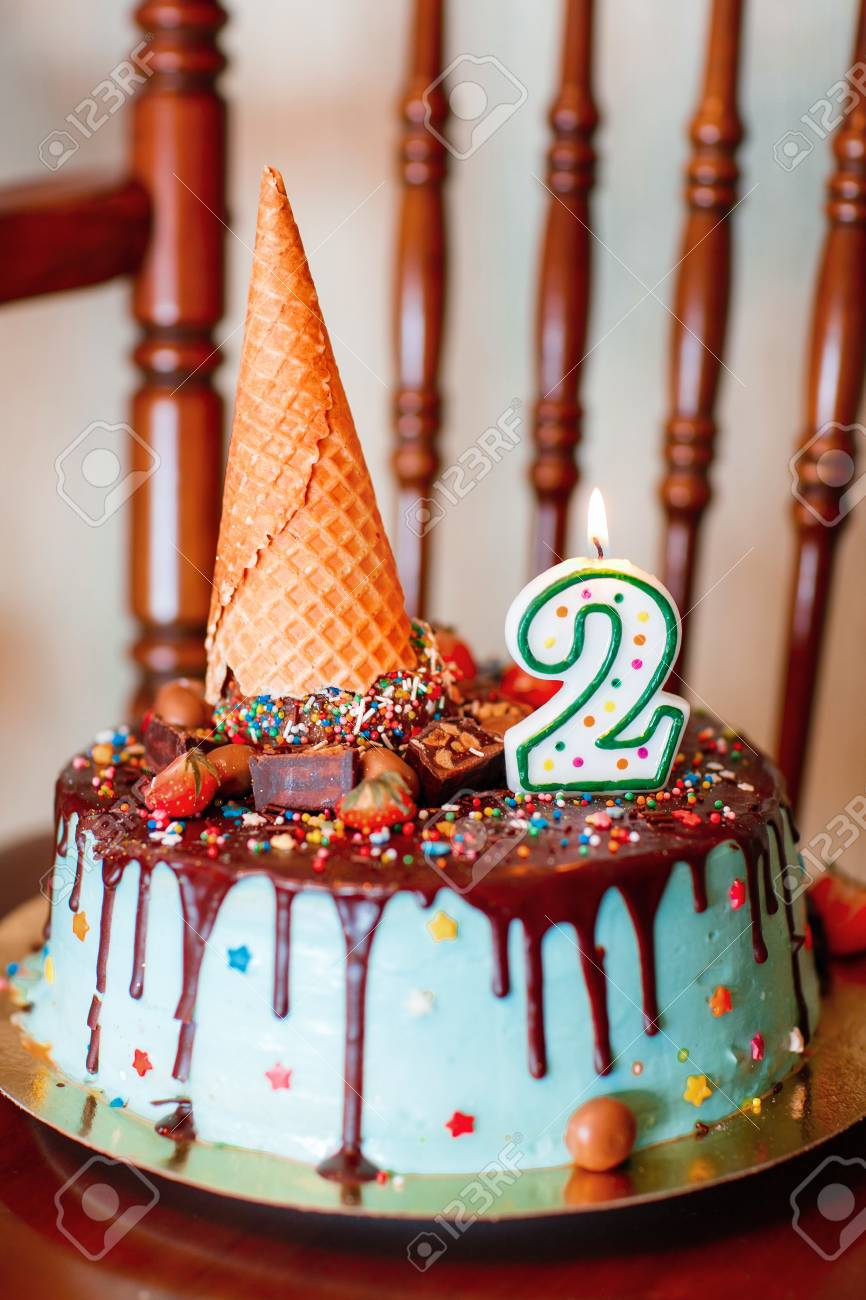 Groovy Cake Birthday Cake With Candles For 2Nd Birthday Stock Photo Funny Birthday Cards Online Inifodamsfinfo