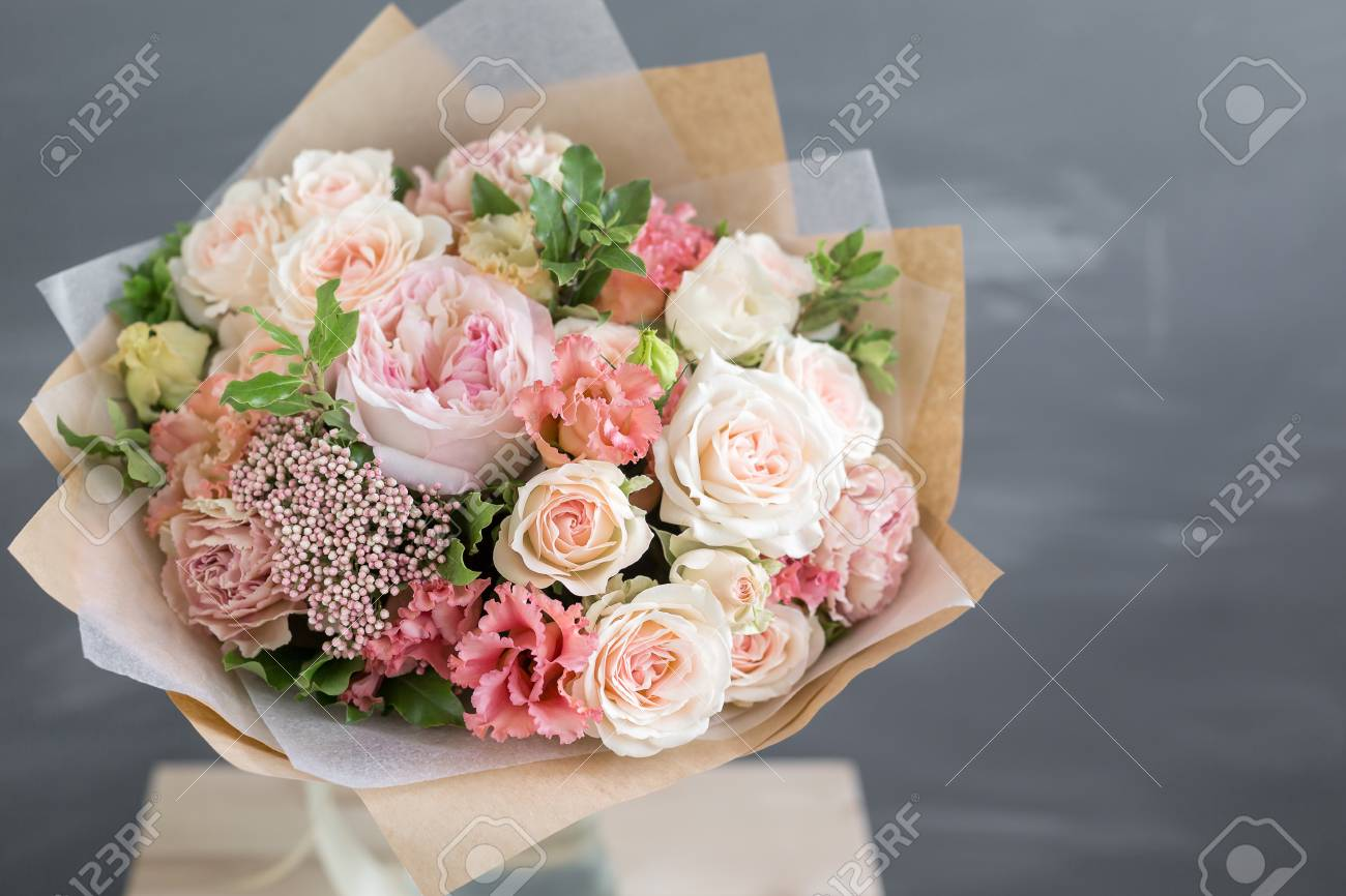 Bouquet In Kraft Paper A Simple Bouquet Of Flowers And Greens Stock