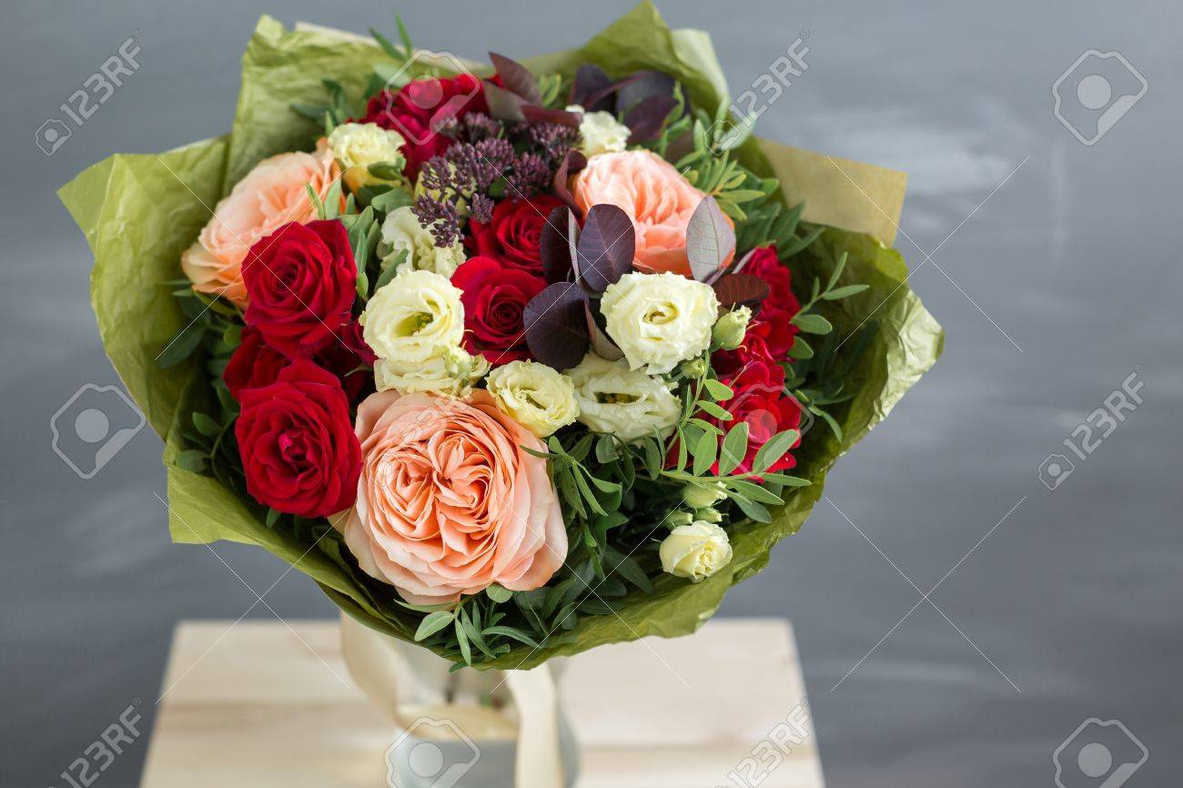 Bouquet in kraft paper a simple bouquet of flowers and greens bouquet in kraft paper a simple bouquet of flowers and greens on a gray izmirmasajfo
