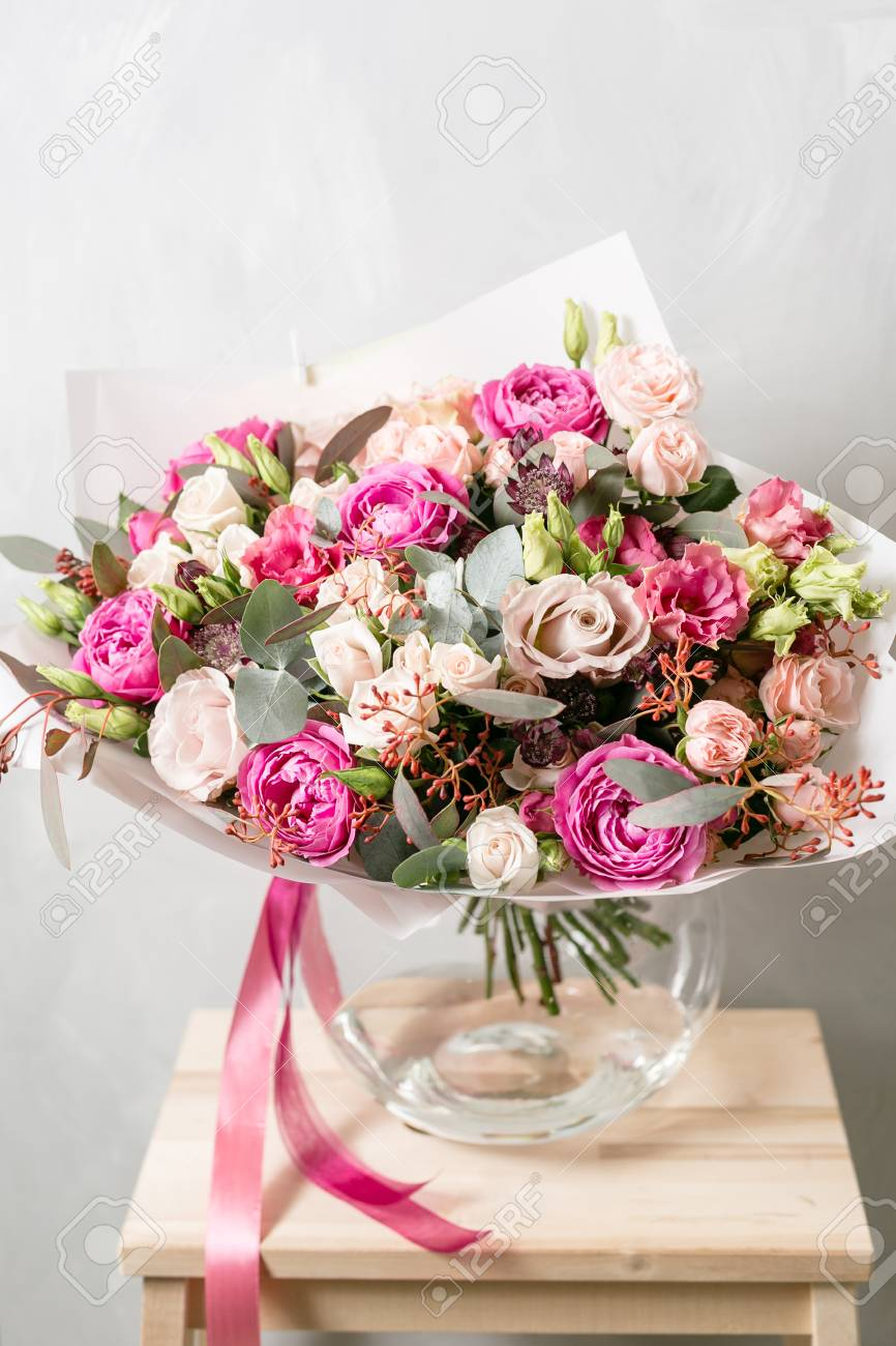 Beautiful bouquet of mixed flowers into a vase on wooden table stock beautiful bouquet of mixed flowers into a vase on wooden table stock photo 89266047 izmirmasajfo