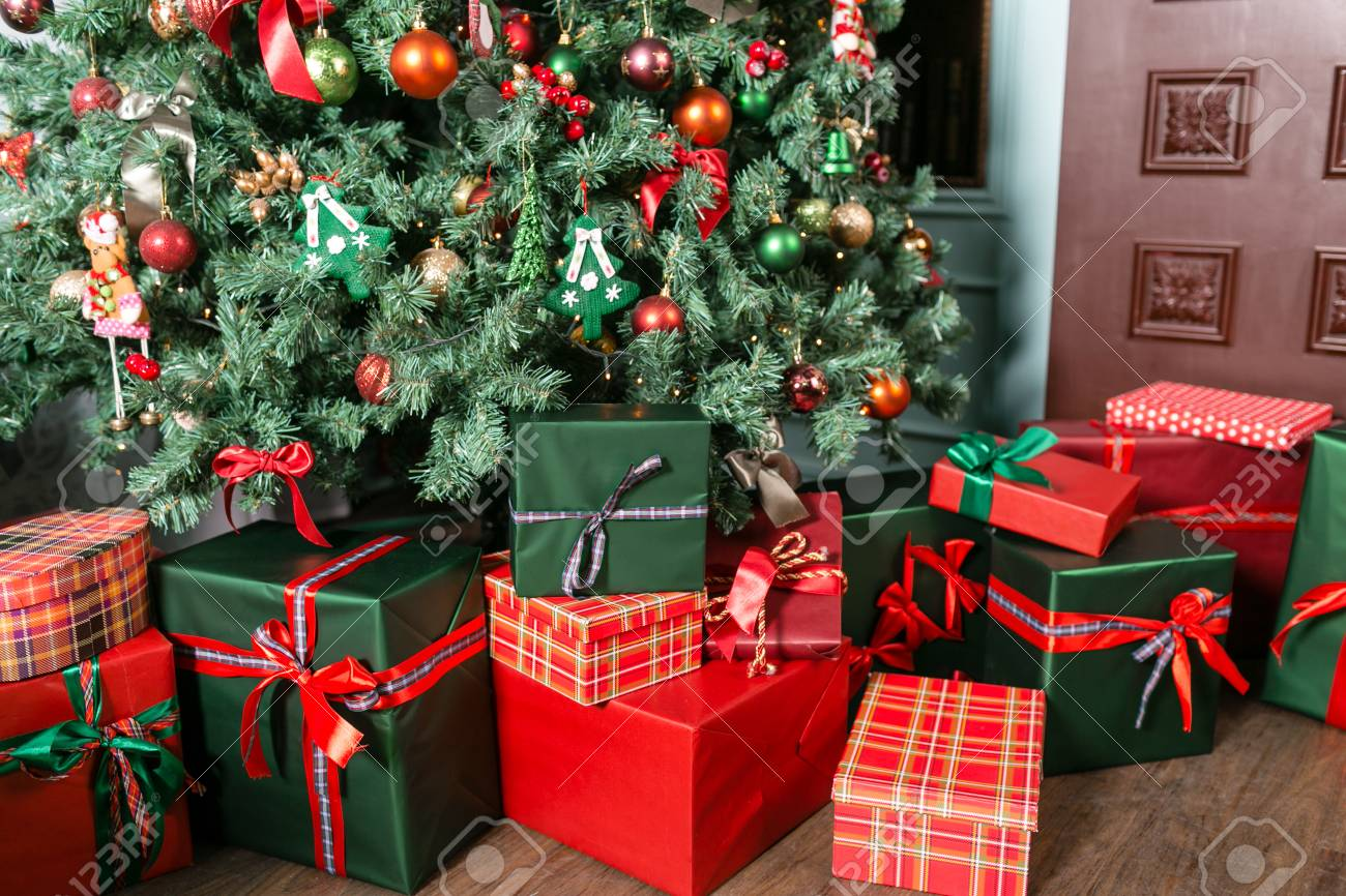 Pile Of Christmas Gifts Close-up Under The Christmas Tree. Red ...