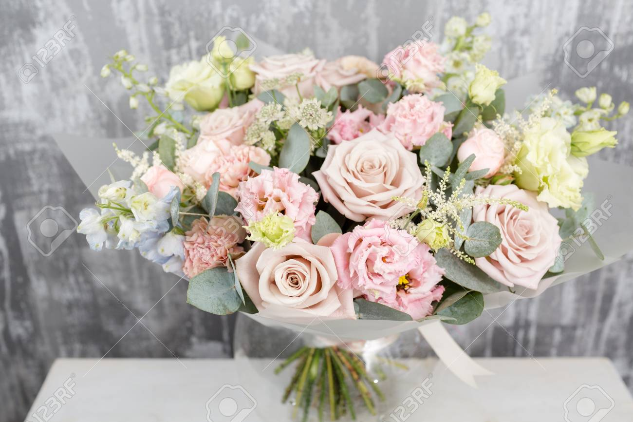 Beautiful Bouquet Of Mixed Flowers Into A Vase On Wooden Table ...