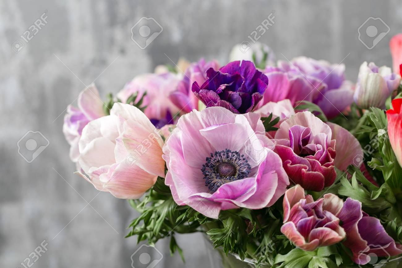 Bouquet of mixed anemones flowers in vase the work of the florist bouquet of mixed anemones flowers in vase the work of the florist at a flower izmirmasajfo