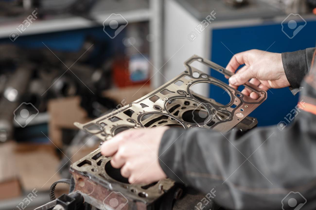 The mechanic disassemble block engine vehicle. Engine on a repair stand with piston and connecting rod of automotive technology. Interior of a car repair shop - 93001890