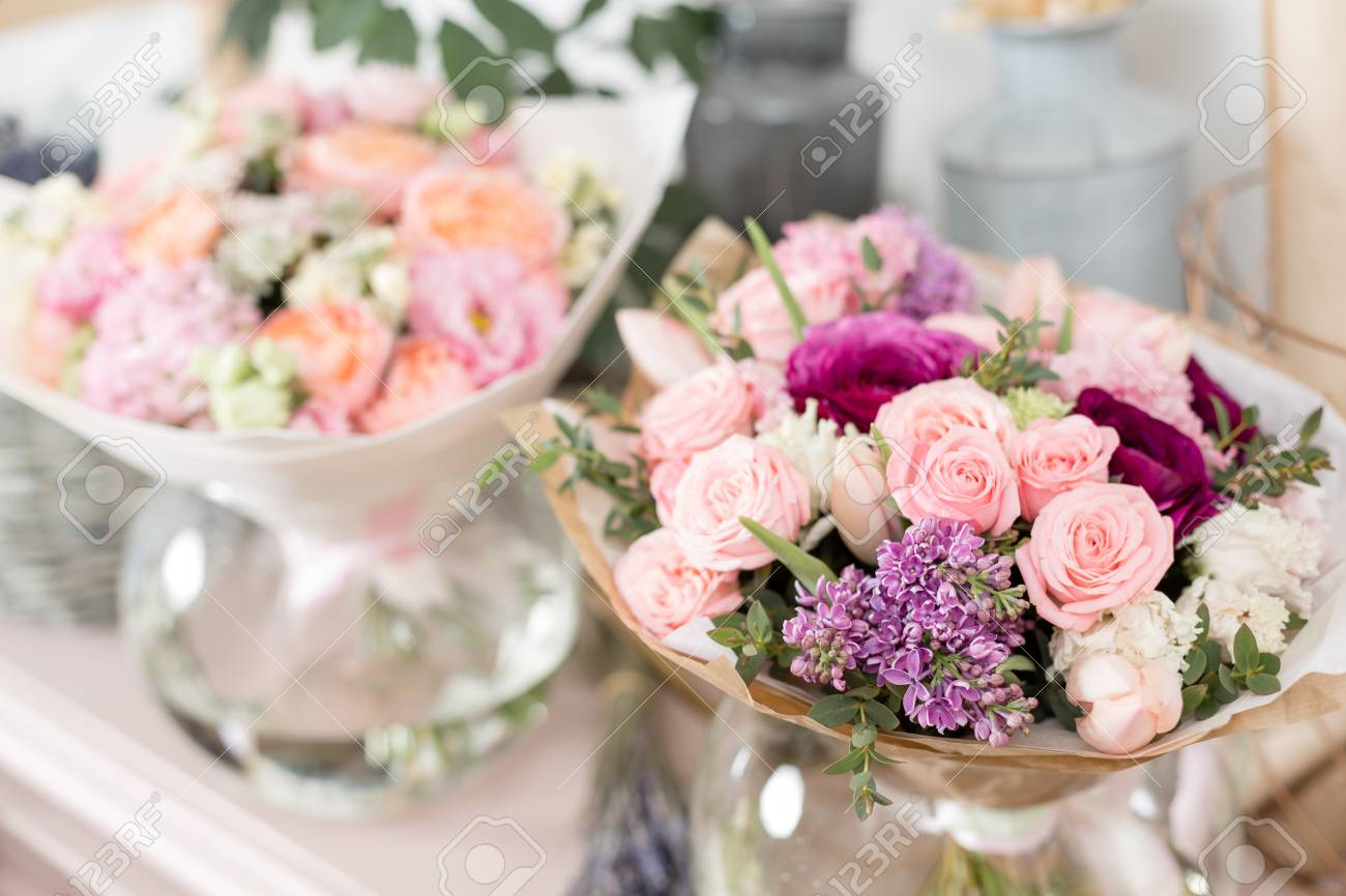 Few Of Beautiful Luxury Bouquet Mixed Flowers On Pink Table
