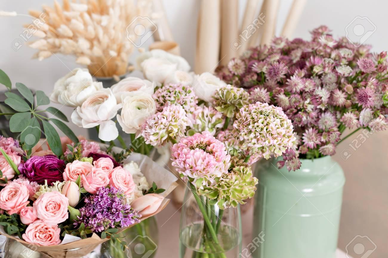 Few of beautiful luxury bouquet mixed flowers on pink table few of beautiful luxury bouquet mixed flowers on pink table the work of the izmirmasajfo