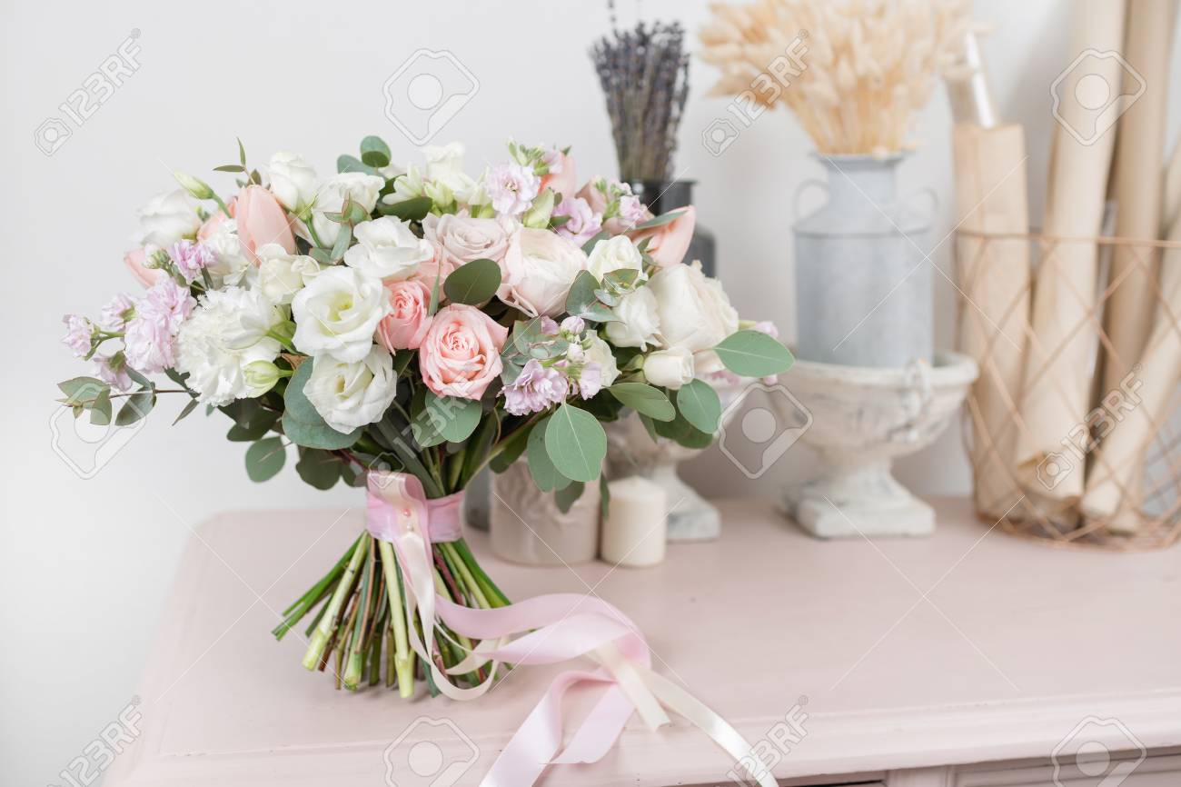 Beautiful luxury bouquet of mixed flowers on pink table the stock beautiful luxury bouquet of mixed flowers on pink table the work of the florist at izmirmasajfo