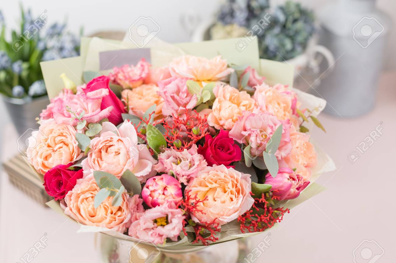 Beautiful Luxury Bouquet Of Mixed Flowers On Pink Table. The.. Stock ...
