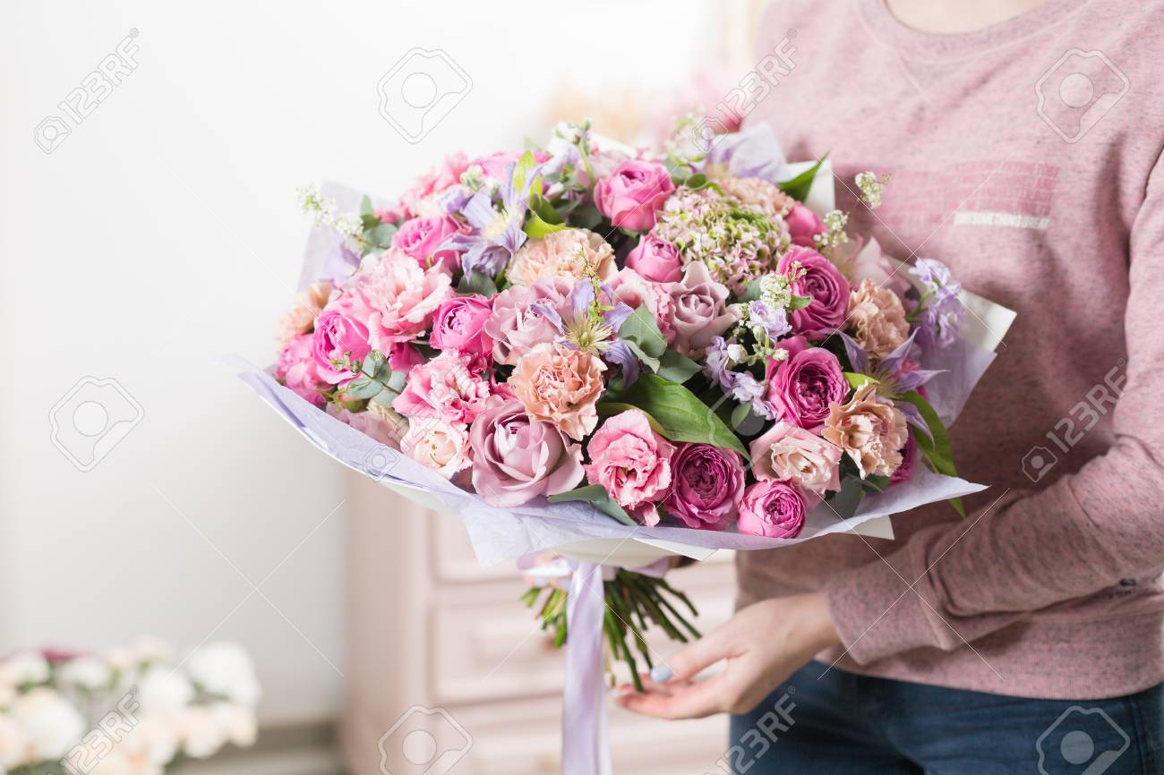 Beautiful luxury bouquet of mixed flowers in woman hand the stock beautiful luxury bouquet of mixed flowers in woman hand the work of the florist at izmirmasajfo Choice Image