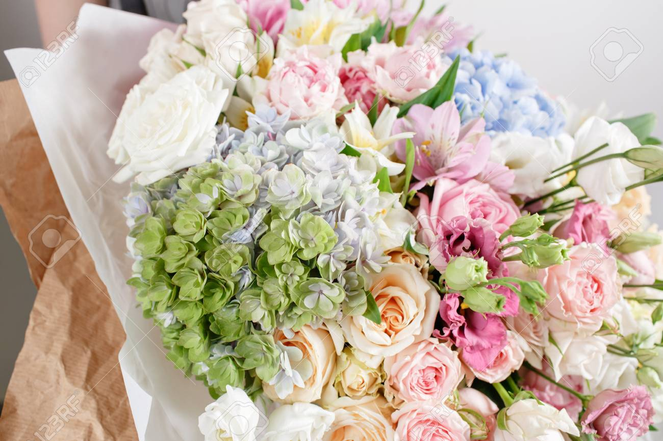 Luxury Bouquets Of Mixed Flowers In The Hands Women. Stock Photo ...