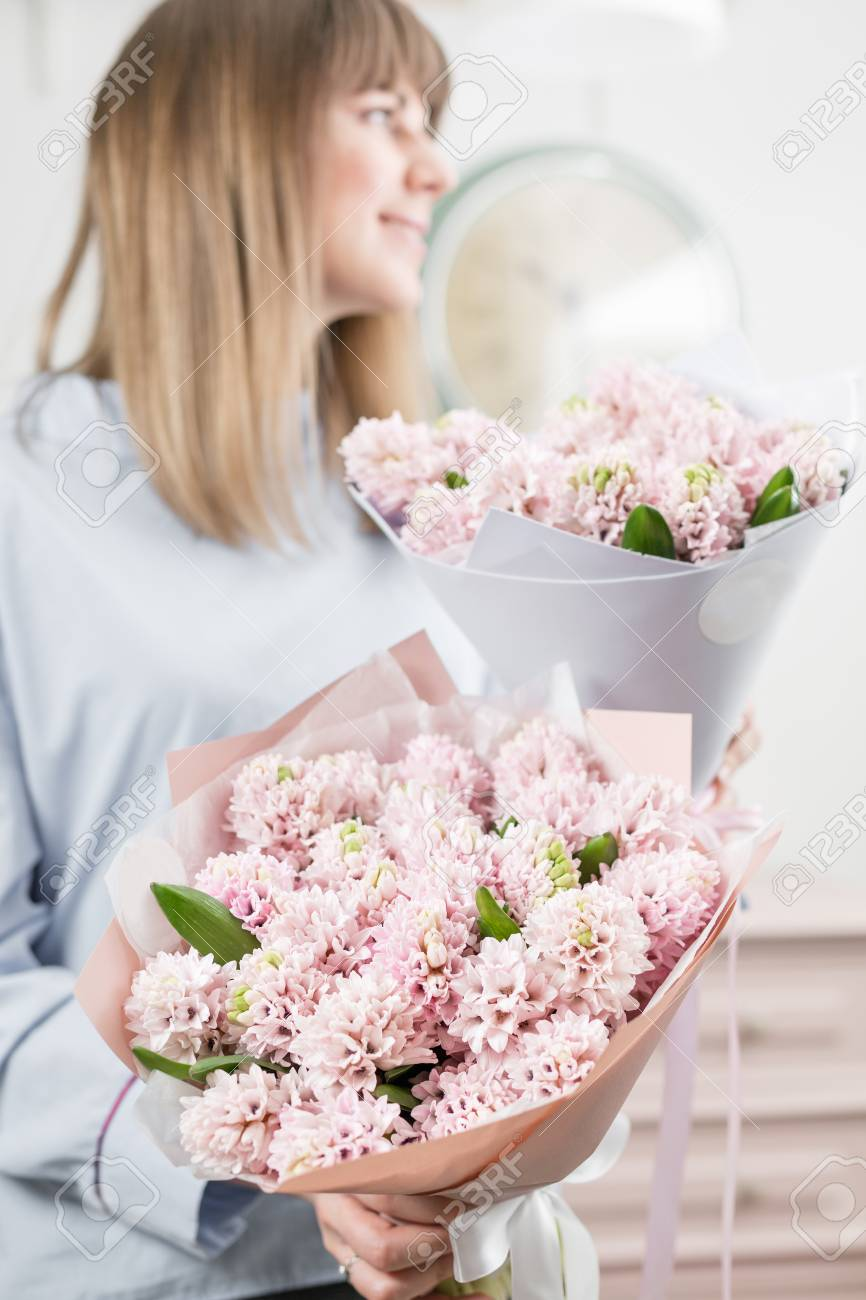 Two flowers bouquet sunny spring morning young happy woman stock stock photo two flowers bouquet sunny spring morning young happy woman holding a beautiful bunch of pink hyacinths in her hands present for a smiles izmirmasajfo