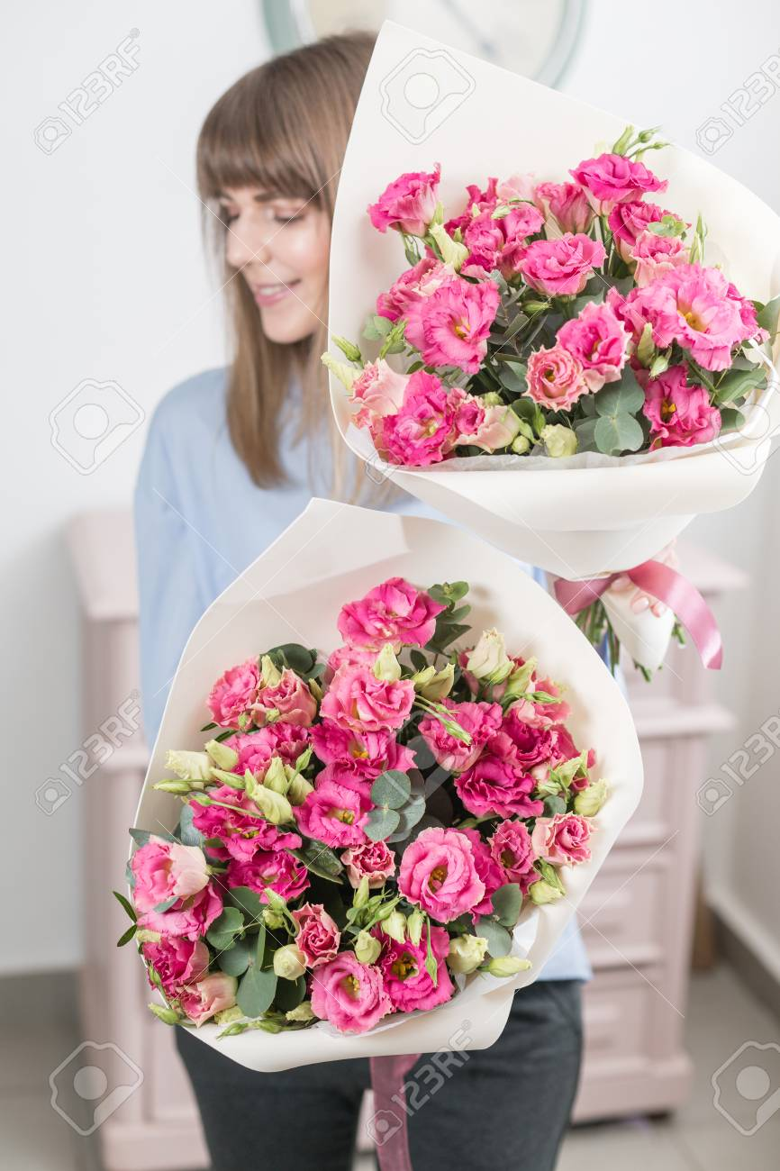 Two flowers bouquet sunny spring morning young happy woman stock stock photo two flowers bouquet sunny spring morning young happy woman holding a beautiful bunch of pink eustoma or lisianthus in her hands present for izmirmasajfo