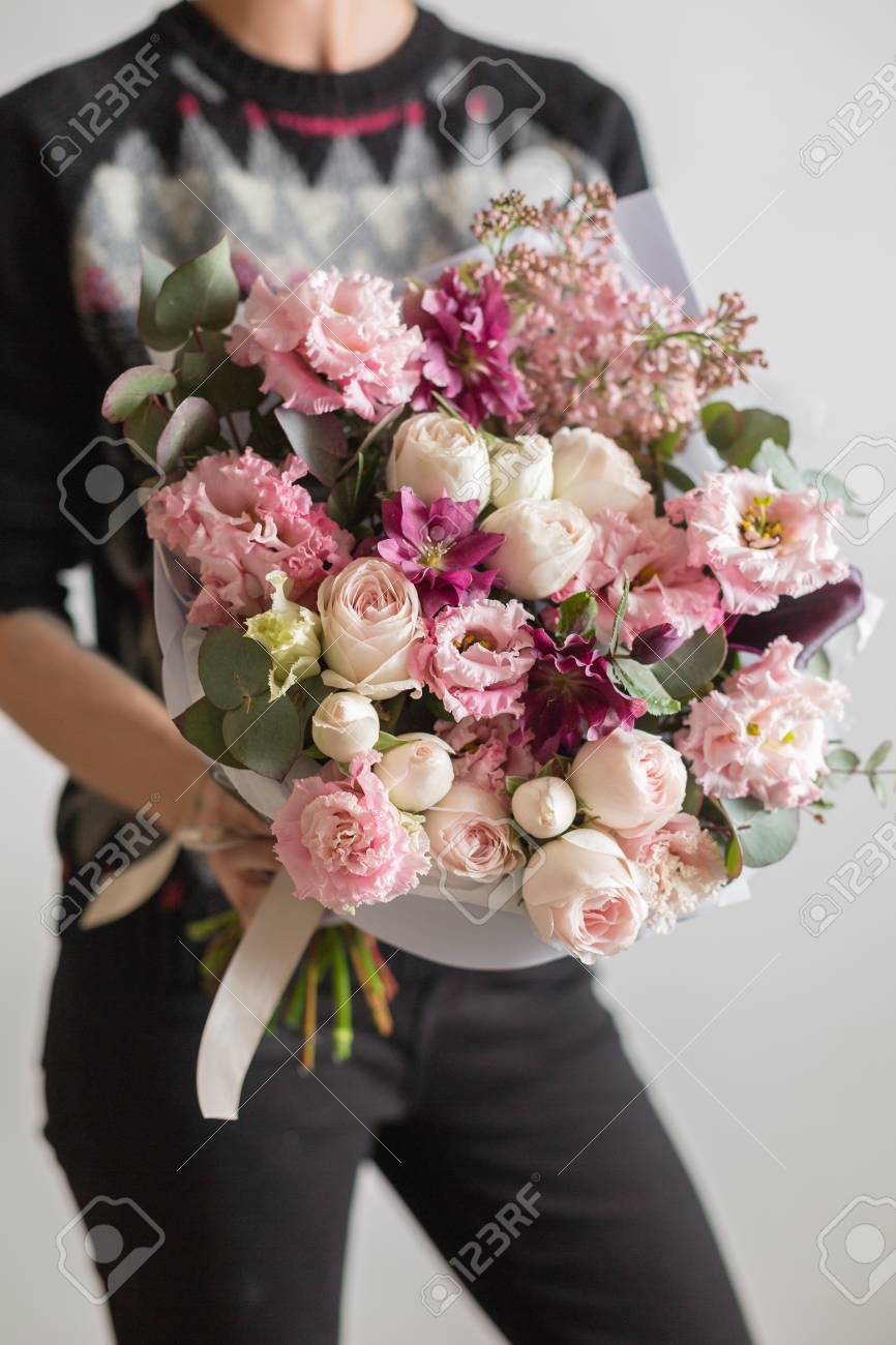 Beautiful luxury bouquet of mixed flowers in woman hand the stock beautiful luxury bouquet of mixed flowers in woman hand the work of the florist at izmirmasajfo