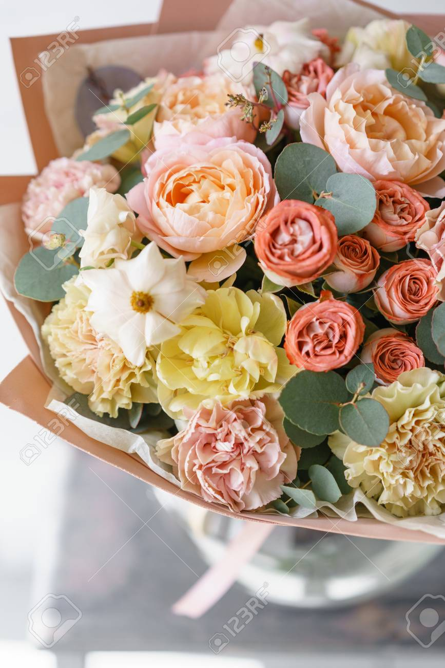 Pastel Orange And Pink Bouquet Of Beautiful Flowers On Wooden ...
