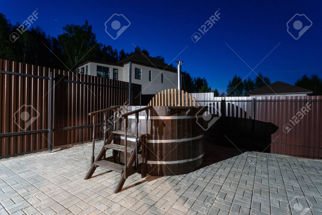 rural wooden water hot tub with stairs garden yard. . night and starry sky - 102162667