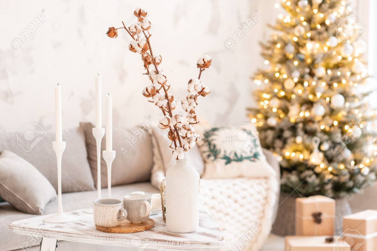 Vase With Cotton Branches Light Living Room With Christmas Tree Stock Photo Picture And Royalty Free Image Image 111792533