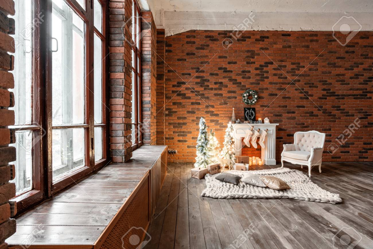 Loft apartments, brick wall with candles and Christmas tree wreath...