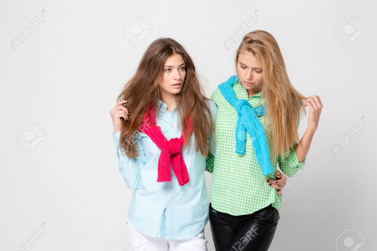 5551bc366e happy girlfriends women in shirts and a sweater on his shoulders. Fashion  spring image of