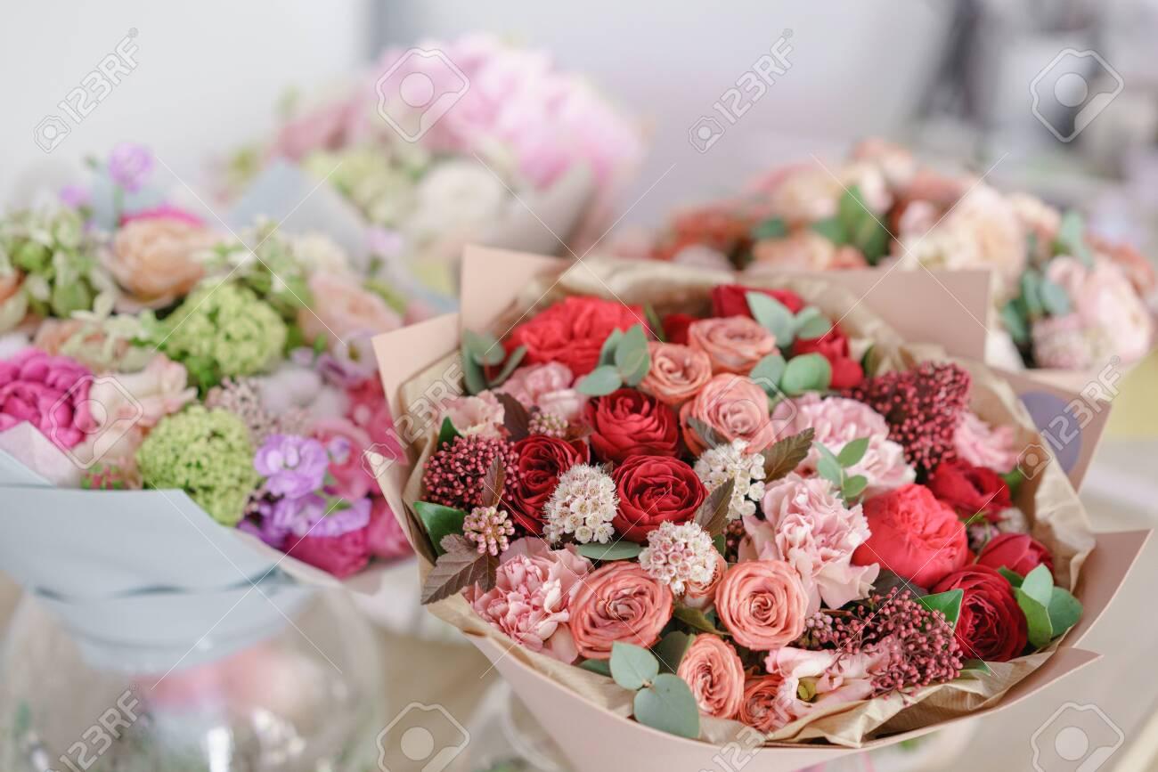 showcase flower shop. Beautiful spring bouquets. Arrangement with mix flowers. Small family business. Work florist. copy space - 124513584